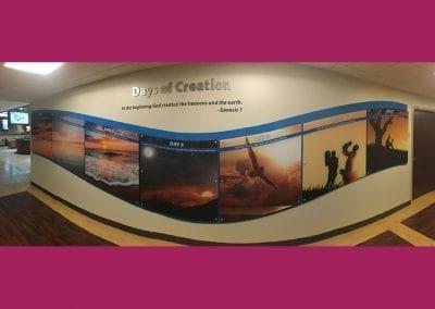 Panoramic photo of custom built wave design Days of Creation wall display