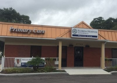 Channel letters spelling Primary Care and new panel for lighted sign