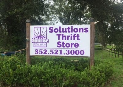 Maxmetal signs affixed to wood posts for Sunrise of Pasco Thrift Store