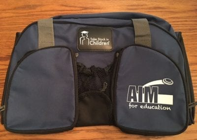 Blue duffel bag with Take Stock in Children and Aim for Education logos