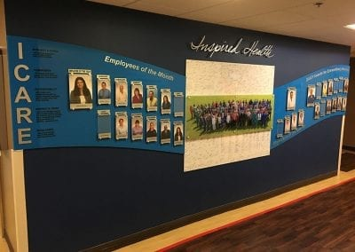Custom built employee recognition wall Inspired Health.