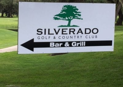 Maxmetal sign hanging from a tree for Silverado Golf and Country Club